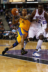 March 14, 2011; Sacramento, CA, USA;  Golden State Warriors shooting guard Monta Ellis (8) is defended by Sacramento Kings center Samuel Dalembert (10) during the second quarter at the Power Balance Pavilion.