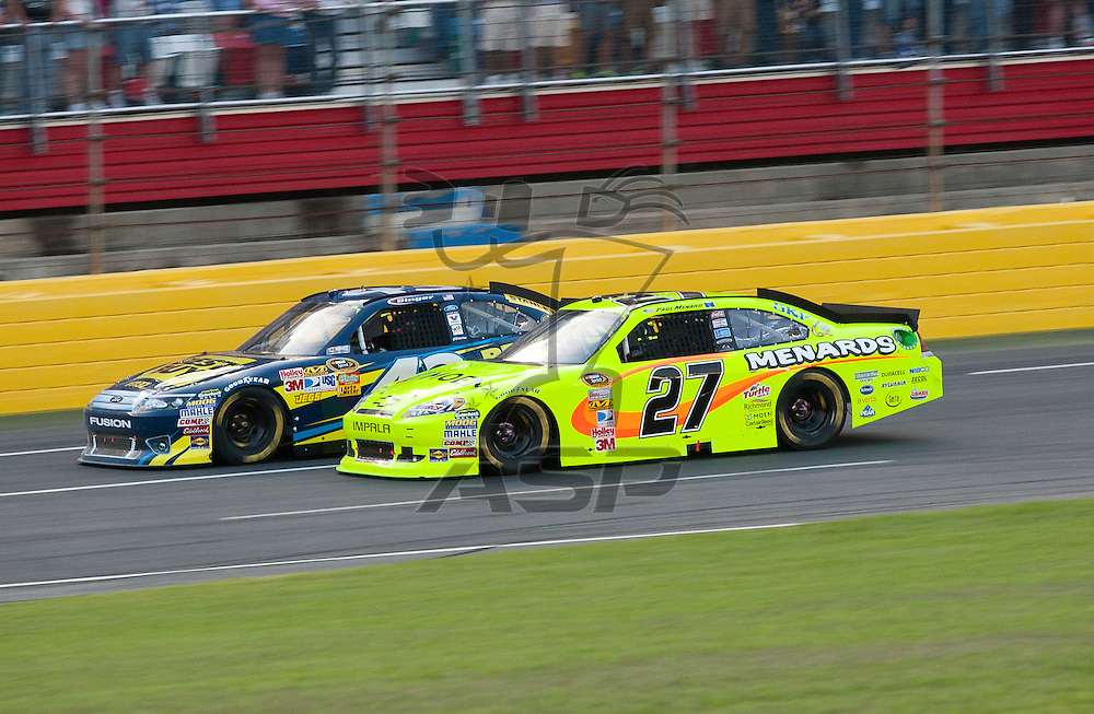 CONCORD, NC - MAY 21, 2011:  Paul Menard and A.J. Allmendinger race to the line during the track for the Showdown at the Charlotte Motor Speedway in Concord, NC.