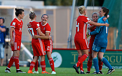 NEWPORT, WALES - Tuesday, June 12, 2018: Wales players celebrate at the final whistle after beating Russia 3-0 during the FIFA Women's World Cup 2019 Qualifying Round Group 1 match between Wales and Russia at Newport Stadium. Hayley Ladd, Jessica Fishlock, Loren Dykes, captain Sophie Ingle, Nadia Lawrence, goalkeeper Laura O'Sullivan. (Pic by David Rawcliffe/Propaganda)