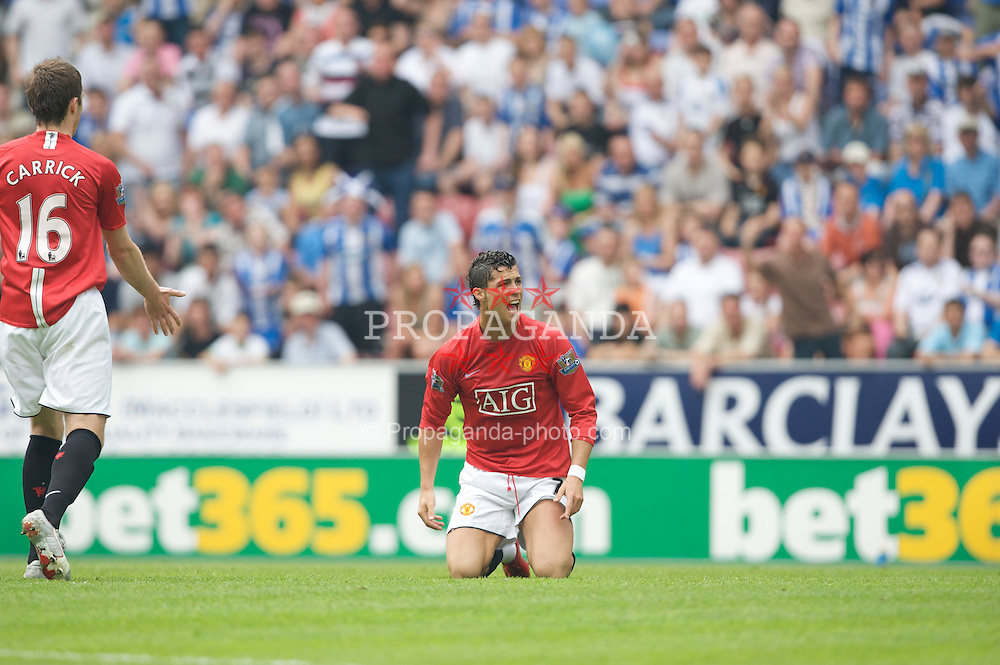 WIGAN, ENGLAND - Sunday, May 11, 2008: Manchester United's Cristiano Ronaldo can't believe the referee hasn't given him a free-kick after he fell over, again, during the final Premiership match against Wigan Athletic of the season at the JJB Stadium. (Photo by David Rawcliffe/Propaganda)