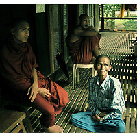 A 76-year-old Burmese man, is sitting next to his monk son in the monastery of Kha Khat Wain Kyaung, the second largest monastery in Burma, now almost vacant. This man who lives in a small village in the countryside, sought to take his son back home.   Many monks in their twenties are now the target of the persecution and repression of the military dictatorship in Burma. Saturday, October 5,2007. Rago, Myanmar (Burma)/