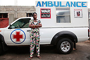 Team Leader Lor before beginning her shift touring the streets of Tshangu. Lor used to live on the streets but now works with the ambulance six nights a week..The ambulance provides both emergency healthcare and also acts as an outreach service - offering guidance and support from women from similar backgrounds who have managed to escape life on the streets. Tshangu district is one of the least safe areas of Kinshasa. It's close to the airport and an army base - and therefore it acts as a magnet for the sex trade...War Child. Kinshasa. DRC...© Zute and Demelza Lightfoot. 0027 (0) 715957313.www.lightfootphoto.com