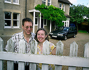 Ordinary husband and wife Mark and Christine Easterfield stand awkwardly at the dirty picket fence with their Volvo car parked on the gravel drive outside their home near Cambridge, England. They are among the thousands of people who have paid the $200,000 fee for a seat on Richard Branson's Virgin Galactic space flights. Aboard the re-usable space vehicle will be 6 passengers, each of whom will have paid $200,000 for the 40 minute flight to 360,000 feet (109.73km, or 68.18 miles) and to experience just 6 minutes of weighlessness. Flights start around 2009/10 from a Mojave desert test facility but therafter, at the new Philippe Starck-designed SpacePort America, New Mexico, USA. a 27 square mile, $225 million headquarters and mission control facility near Las Cruces.  ...