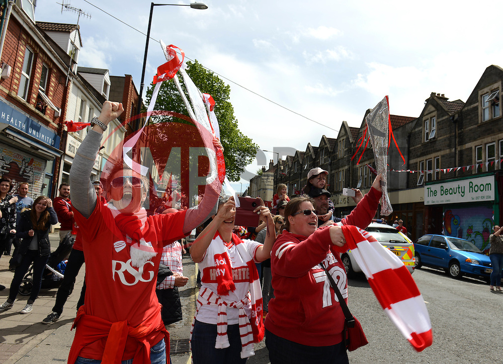 Bristol City fans look on as the Bristol City celebration tour bus passes - Photo mandatory by-line: Dougie Allward/JMP - Mobile: 07966 386802 - 04/05/2015 - SPORT - Football - Bristol -  - Bristol City Celebration Tour