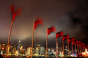 Flags of the Swire Group of companies flutter in Monsoonal winds on the night of the Handover of sovereignty from Britain to China, on 30th June 1997, in Hong Kong, China. Midnight signified the end of British rule, and the transfer of legal and financial authority back to China. Hong Kong was once known as 'fragrant harbour' (or Heung Keung) because of the smell of transported sandal wood.
