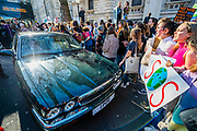The occupents of a chauffeur driven Jaguar are handed a leaflet saying 'wake up you old farts' - School students go on strike over the lack of action on climate change. They gather in Parliament square and march on Downing Street, blocking the streets around westminster for over an hour.