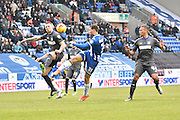 Wigan Athletic Forward, Yanic Wildschut uleashes a shot but it hits Bury Defender, Peter Clarke during the Sky Bet League 1 match between Wigan Athletic and Bury at the DW Stadium, Wigan, England on 27 February 2016. Photo by Mark Pollitt.