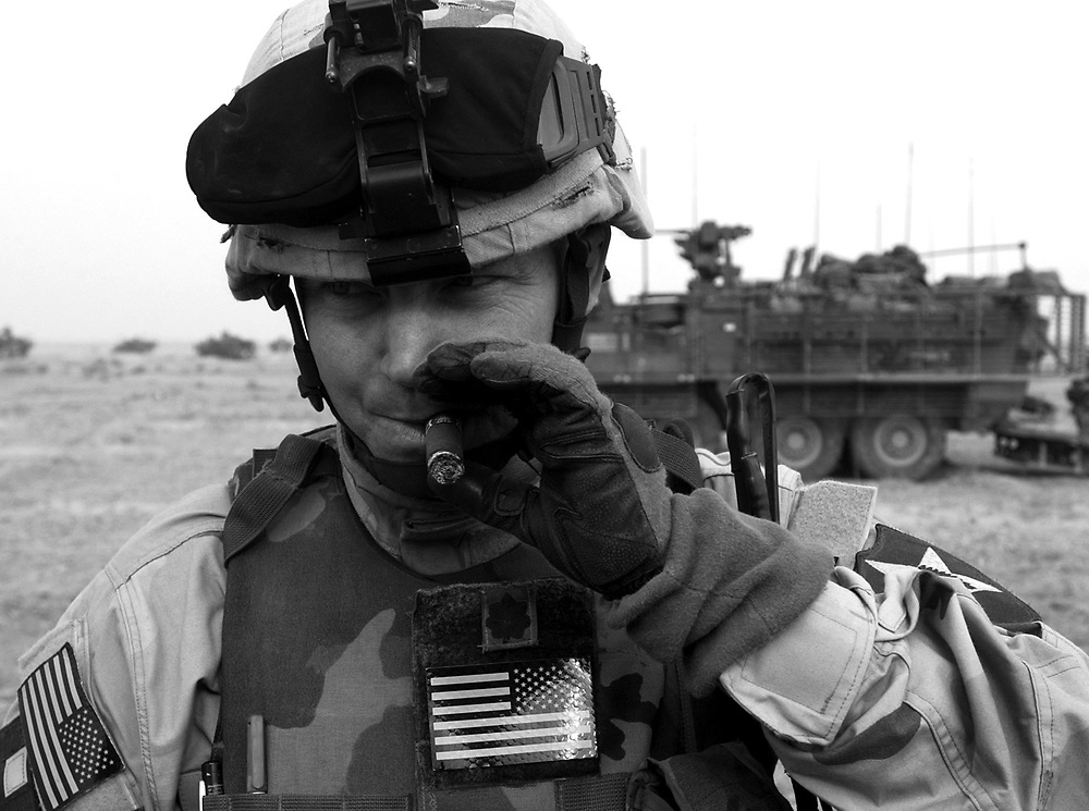 Victory Cigar.Lt. Col. Karl Reed; commander of the 5th Battalion; 20th Infantry Regiment, 3rd Brigade, 2nd ID, the Army's first Stryker Brigade, smokes a cigar the morning after his Battalion successfully raided a series of loyalist targets in Samarra, Iraq. This was the first major operation for the 3rd Brigade after deploying into Iraq in December 2003.