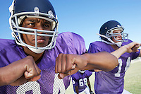 Two Football Players clenching fists on field close-up (close-up)
