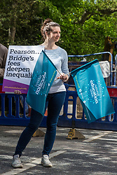 London, UK. 4th May, 2018. Members of the National Education Union (NEU) demonstrate outside the AGM of multinational assessment service Pearson in protest against investment by the corporation in 'low-fee' private schools provider Bridge. Bridge, one of the world's largest education-for-profit companies, aims to extend its influence throughout Africa and Asia.