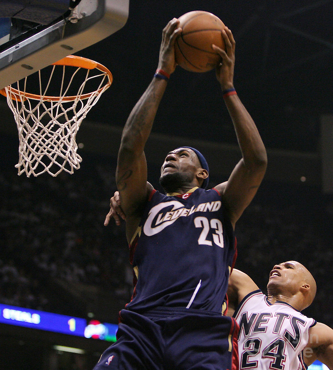 The Cavaliers' LeBron James (L) drives to the basket past the Nets' Richard Jefferson (R) during the first half of game 6 of the Eastern Conference semifinals between the Cleveland Cavaliers and the New Jersey Nets at Continental Airlines Arena in East Rutherford, New Jersey on 18 May 2007.