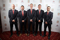 CARDIFF, WALES - Monday, October 5, 2015: Wales' physiotherapist Sean Connelly, physiotherapist David Weeks, Medical Officer Doctor Jon Houghton, masseur David Rowe and masseur Chris Senior during the FAW Awards Dinner at Cardiff City Hall. (Pic by Pete Thomas/Propaganda)