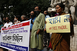 October 9, 2018 - Dhaka, Bangladesh - Different University Teasers called a protest on black cloth on the face of the demand release colleague near Aparajeyo Bangla at Dhaka University Campus. Maidul Islam, a teacher of Chittagong University, who was arrest under section 57 of the ITC Act for making derogatory remaks about the prime minister on Facebook. (Credit Image: © MD Mehedi Hasan/ZUMA Wire)