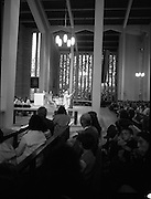 "Fr Niall O'Brien says Thanksgiving Mass.1984..16.07.1984..07.16.1984..16th July 1984..In celebration of his safe homecoming from the Philippines,Fr Niall O'Brien said a thanksgiving mass At Newtownpark Ave,Blackrock,Dublin. Along with two other priests and six lay people,Fr Niall was falsly accused of multiple murders.They became known as ""The Negros Nine"".After President Reagan visited Ireland,The American government put pressure on the Marcos regime and all charges were dropped and all were fully exonerated...A view of Fr Niall O'Brien as he address a packed congregation from the altar...Note; Fr O'Brien, who was born in Dublin in 1939,died in Pisa, Italy in 2004"