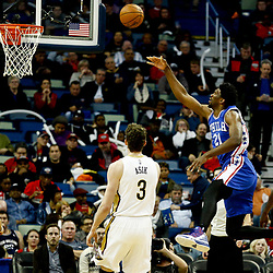 Dec 8, 2016; New Orleans, LA, USA;  Philadelphia 76ers center Joel Embiid (21) shoots over New Orleans Pelicans center Omer Asik (3) and forward Solomon Hill (44) during the second half of a game at the Smoothie King Center.  The 76ers defeated the Pelicans 99-88. Mandatory Credit: Derick E. Hingle-USA TODAY Sports