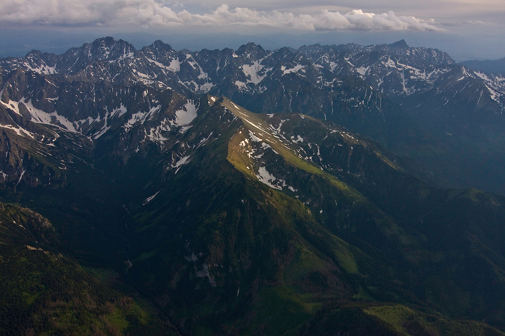 Aerial view of the northern side of the High Tatras, with mount Gerlach (2665m asl) on the left and Mount Krivàn (2495m asl) on the right. On the background the Low Tatras. High Tatras, Slovakia. June 2009. Mission: Ticha