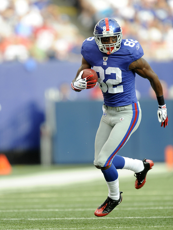 EAST RUTHERFORD, NJ - SEPTEMBER 13: Mario Manningham #82 of the New York Giants runs with the ball against the Washington Redskins during their game on September 13, 2009 at Giants Stadium in East Rutherford, New Jersey. (Photo by Rob Tringali) *** Local Caption *** Mario Manningham