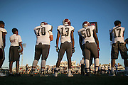 Greece Arcadia players watch from the sideline during a game at Eastridge High School on Friday, September 2, 2016.