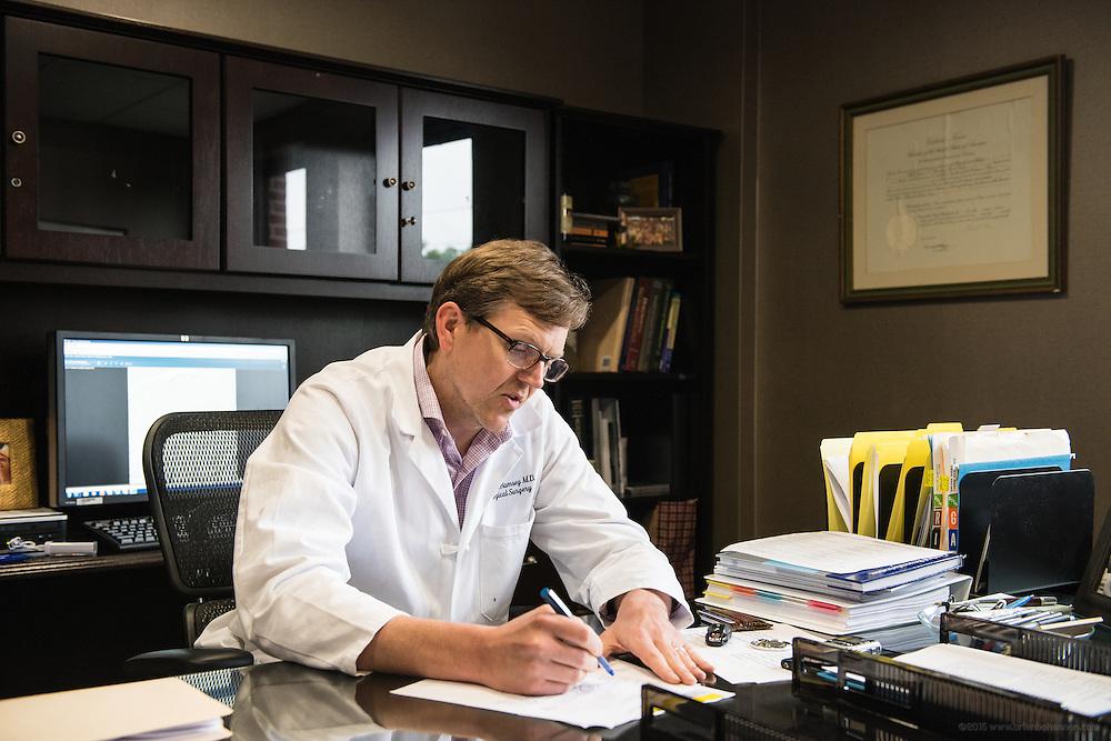Neurosurgeon Christian N. Ramsey, MD, FAANS, photographed Thursday, May 21, 2015 at Baptist Health in Lexington, Ky. (Photo by Brian Bohannon/Videobred for Baptist Health)