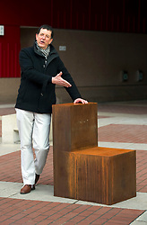 © Licensed to London News Pictures. 13/12/2011 London, UK. .Antony Gormley unveils his new sculpture, 'Witness' outside The British Library, London. The piece was commissioned by English PEN to mark it's 90th anniversary and is cast in iron depicting an empty chair to represent writers around the world..Photo credit : Simon Jacobs/LNP
