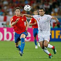 Photo: Glyn Thomas.<br />Spain v Tunisia. FIFA World Cup 2006. 19/06/2006.<br /> Tunisia's Jaouhar Mnari (R) and Spain's Fernando Torres.