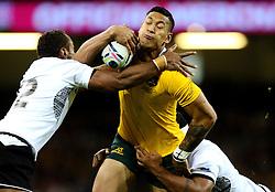 Fiji Inside Centre Gabiriele Lovobalavu tackles Australia Full Back Israel Folau  - Mandatory byline: Joe Meredith/JMP - 07966386802 - 23/09/2015 - Rugby Union, World Cup - Millenium Stadium -Cardiff,Wales - Australia v Fiji - Rugby World Cup 2015 - Pool A