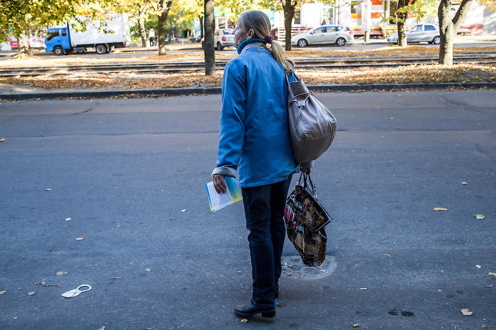 DNIPROPETROVSK, UKRAINE - OCTOBER 12: Svitlana Kostromina waits for a bus on the long trip from the Good News Evangelical Church to the home where she, her daughter, and granddaughter are living with a family that is part of the congregation on October 12, 2014 in Dnipropetrovsk, Ukraine. Yeva and her family fled fighting in Luhansk. The United Nations has registered more than 360,000 people who have been forced to leave their homes due to fighting in the East, though the true number is believed to be much higher.(Photo by Brendan Hoffman/Getty Images) *** Local Caption *** Svitlana Kostromina