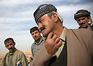 Iraq, Kurdistan, Kirkuk, kurdish peshmergas veteran showing a wound on his neck