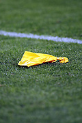 A yellow penalty flag lies on the grass after being thrown by an official during the Denver Broncos 2017 NFL week 1 regular season football game against the Los Angeles Chargers, Monday, Sept. 11, 2017 in Denver. The Broncos won the game 24-21. (©Paul Anthony Spinelli)