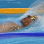 A blur of motion of a swimmer in action during the swimming heats at the Aquatic Centre at Olympic Park, Stratford during the London 2012 Olympic games. London, UK. 29th July 2012. Photo Tim Clayton