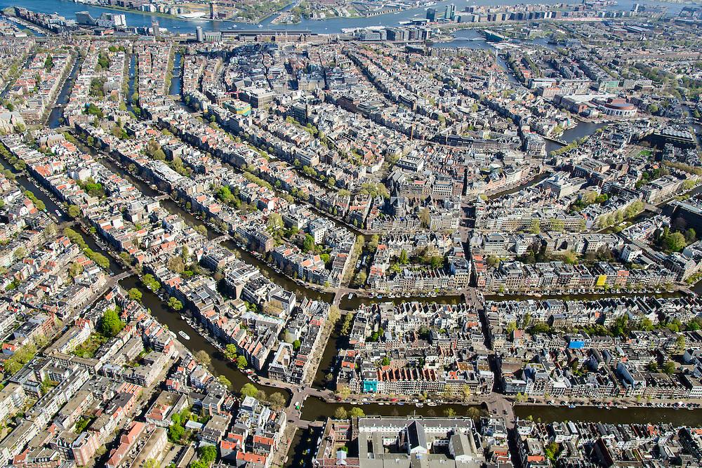 Nederland, Noord-Holland, Amsterdam, 09-04-2014;<br /> Binnenstad en grachtengordel, Leidsegracht en Leidsestraat doorsnijdt de Prinsengracht, Keizergracht en Herengracht.<br /> Boven in beeld het IJ, het Centraal Station,  Oosterdokseiland en Java-eiland.<br /> Center and ring of canals of Amsterdam, seen from the south. Top pic: Amsterdam-Noord (north) on the horizon en newly constructed residential districts on the isles.<br /> luchtfoto (toeslag op standard tarieven);<br /> aerial photo (additional fee required);<br /> copyright foto/photo Siebe Swart