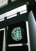 Image of Starbucks Coffee storefront in downtown Seattle, Washington, Pacific Northwest