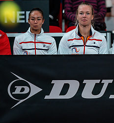 Lesley Pattinama Kerkhove and Kiki Bertens watching   the match Arantxa Rus against Aryna Sabalenka in the Fed Cup qualifier against Belarus in Sportcampus Zuiderpark, The Hague, Netherlands