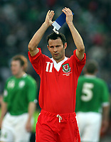 Photo: Paul Thomas.<br /> Republic of Ireland v Wales. European Championships 2008 Qualifying. 24/03/2007.<br /> <br /> Captain Ryan Giggs of Wales thanks heir fans.