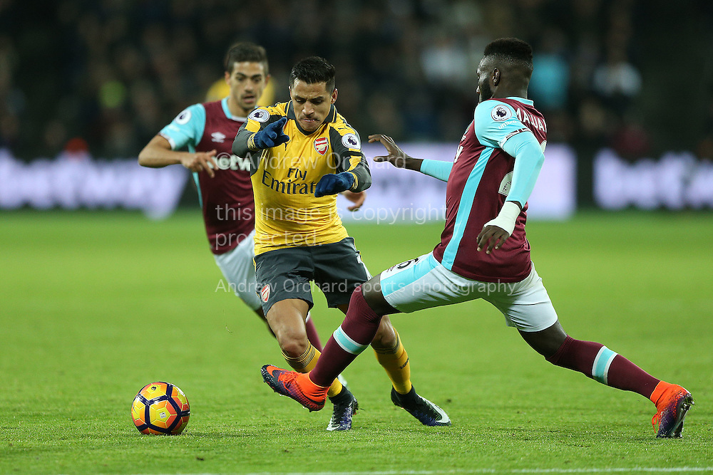 Alexis Sanchez of Arsenal goes past Arthur Masuaku of West Ham United. Premier leaguePremier league match, West Ham Utd v Arsenal at the London Stadium, Queen Elizabeth Olympic Park in London on Saturday 3rd December 2016.<br /> pic by John Patrick Fletcher, Andrew Orchard sports photography.