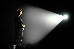 "Brian McFadden in the spotlight during when Westlife play their third consecutive concert at the Hallam FM Arena at the start of their ""Unbreakable"" Tour 2003 Monday 21st July 2003<br /> <br /> Image Copyright Paul David Drabble<br /> 21 July 2003"