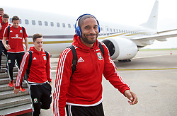CARDIFF, WALES - Sunday, October 11, 2015: Wales' captain Ashley Williams steps off the team plane as the squad return to Cardiff Airport after qualifying for UEFA Euro 2016 after the UEFA Euro 2016 qualifying match against Bosnia and Herzegovina. (Pic by David Rawcliffe/Propaganda)