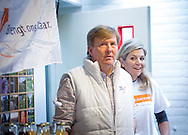 TRICHT - King Willem-Alexander and Queen Maxima of The Netherlands help painting the gym of community center during NL Doet  in Tricht, The Netherlands, 21 March 2015. NL Doet is an volunteer day organized by the Oranje Fonds. Photo: Robin Utrecht