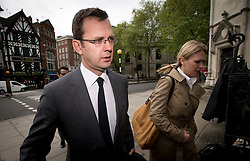 © London News Pictures. 08/05/2012. London, UK. Former News of the World editor ANDY COULSON (left) arriving at the Rpoyal Courts of Justice in London on May 8, 2012 to make an application to appeal against High Court ruling that Newsgroup Newspapers is not liable for his legal fees in phone hacking actions. Photo credit: Ben Cawthra/LNP