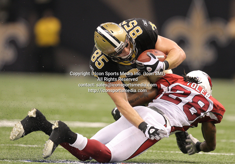 16 January 2010:  Arizona Cardinals cornerback Greg Toler (28) stops New Orleans Saints tight end David Thomas (85) short of a first down during a 45-14 win by the New Orleans Saints over the Arizona Cardinals in a 2010 NFC Divisional Playoff game at the Louisiana Superdome in New Orleans, Louisiana.