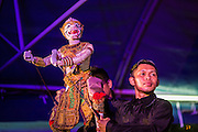 "24 JULY 2014 - BANGKOK, THAILAND: Traditional puppeteers perform the Ramakien (the Thai version of the Ramayana) with a Hanuman puppet at the happiness party in Bangkok. The Thai Junta is organizing a series of public events throughout Thailand meant to bolster public opinion. The events are called ""restoring happiness to the people"" parties. They feature historic pageants, music, food, health checks and free haircuts. The party in Bangkok is on Sanam Luang, the Royal Parade Ground, which is near the Grand Palace and the Ministry of Defense.    PHOTO BY JACK KURTZ"