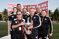 NEWTOWN, WALES - Sunday, May 6, 2018: Connahs Quay Nomad manager Andy Harrison poses with back room staff and the FAW Welsh Cup after a 4-1 victory over Aberystwyth Town in the FAW Welsh Cup Final between Aberystwyth Town and Connahs Quay Nomads at Latham Park. (Pic by Paul Greenwood/Propaganda) Jay Catton, Neil Gibson, Neil Ebbrell, Mark Rowlands, Gemma Bamford, Mal Latter