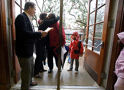 17 Jan, 2006. New Orleans, Louisiana. Post Katrina.<br />  School re-opening. Principal Kathy Riedlinger (2nd left) greets parents and children returning to Lusher Charter School in uptown New Orleans on their first day back since Hurricane Katrina. Kathy lost her home and all her possessions to the storm and is currently living with friends. The school suffered $2 million in damages and has been repaired and returned to service with the help of contractors and parents who have worked tirelessly to re-open the facility to students.<br /> Photo; Charlie Varley/varleypix.com