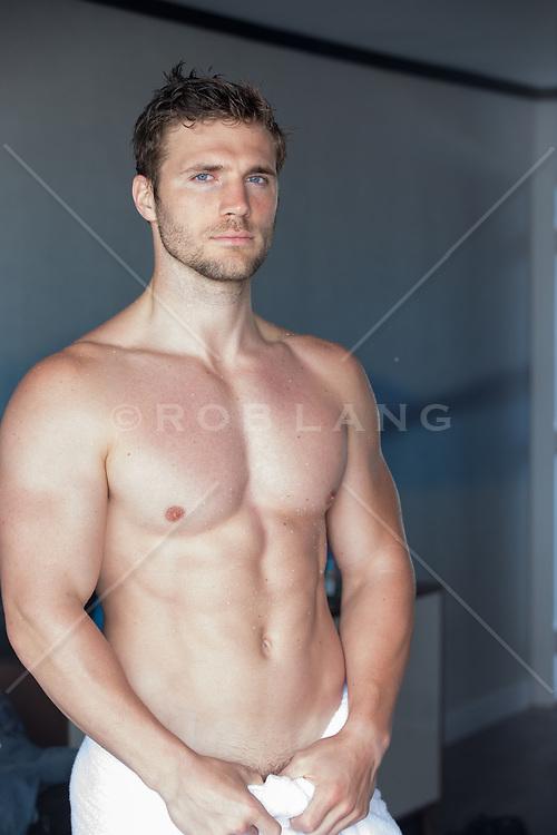 shirtless muscular man in a doorway