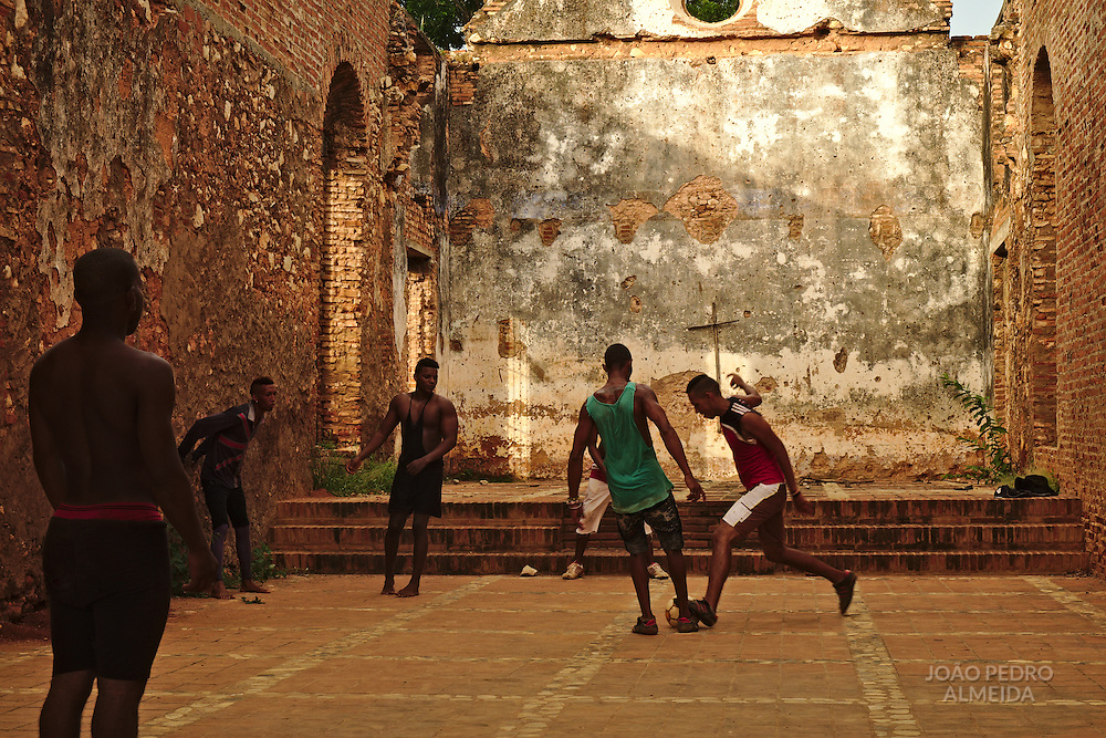 Boys playing a football match in the ruins of Santa Ana church
