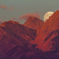 A harvest moon rises over Montana's Mission range, heralding autumn 2010