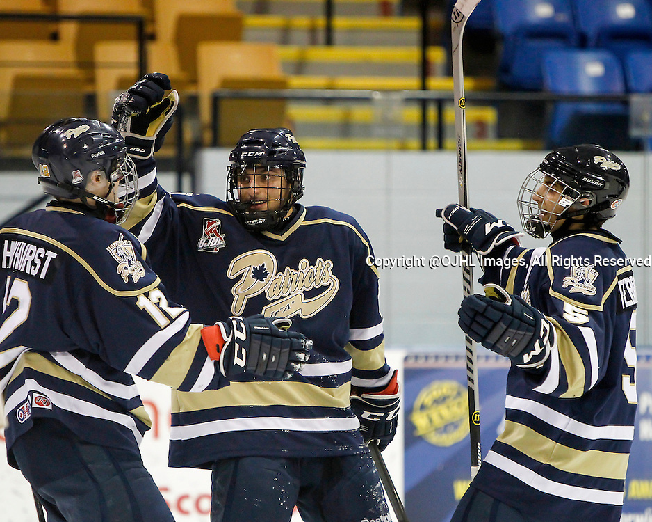 NEWMARKET, ON - Dec 18, 2014 : Ontario Junior Hockey League game action between Toronto and Newmarket, Toronto Patriots celebrate the goal during the second period.<br /> (Photo by Brian Watts / OJHL Images)