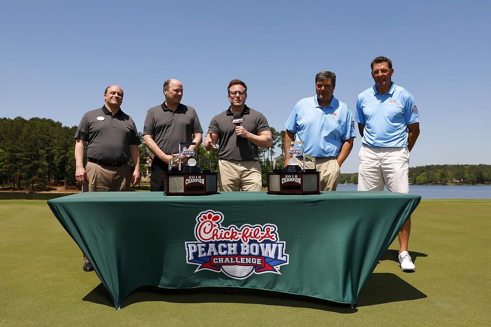 Matt Luke and Wesley Walls are presented with the Peach Bowl Challenge Trophy after winning the Chick-fil-A Peach Bowl Challenge at the Oconee Golf Course at Reynolds Plantation, Sunday, May 1, 2018, in Greensboro, Georgia. (Paul Abell via Abell Images for Chick-fil-A Peach Bowl Challenge)