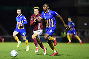 Shrewsbury Town defender Omar Beckles (6) chases down the ball under pressure from Northampton Town midfielder Shaun McWilliams (17) during the EFL Sky Bet League 1 match between Northampton Town and Shrewsbury Town at Sixfields Stadium, Northampton, England on 20 March 2018. Picture by Dennis Goodwin.