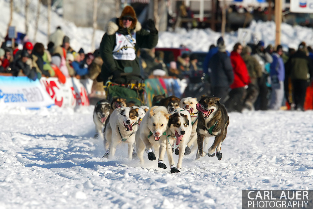 3/4/2007:  Willow, Alaska -  Veteran Ed Iten of Kotzebue, AK is led across Willow Lake by his team of dogs for the start of the 35th Iditarod Sled Dog Race